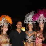Three Brazilian Dancers Roving meet and greet a gentleman at corporate function for Hong Kong Indian Association