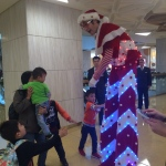 Showing off his amazing LED costume to a young patron at Citiplaza.