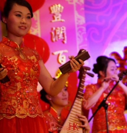 Three Hong Kong Chinese music musicians playing Chinese traditional instrument Bamboo Castanet , Pipa and Xiao at a New year event