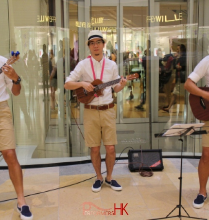 Three Ukulele players performing in Hong Kong shopping mall