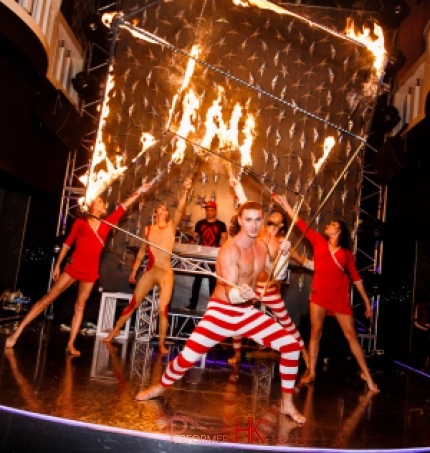 Five talented fire performer in Hong Kong performing with fire staff and fire cube at a night club store opening event