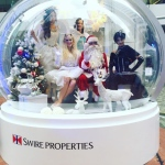 Santa and Xmas angel models performing in Tai Koo Citiplaza for the Swire Faire.