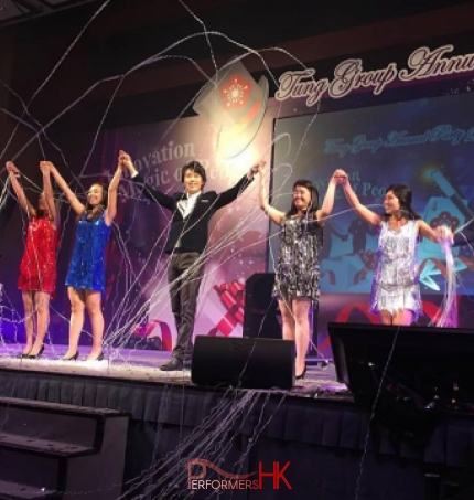 Magician perform magic with Hong Kong Student on stage at a corporate annual dinner