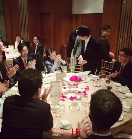 Magician in Hong Kong performing table magic with cards to a lady at a corporate annual dinner