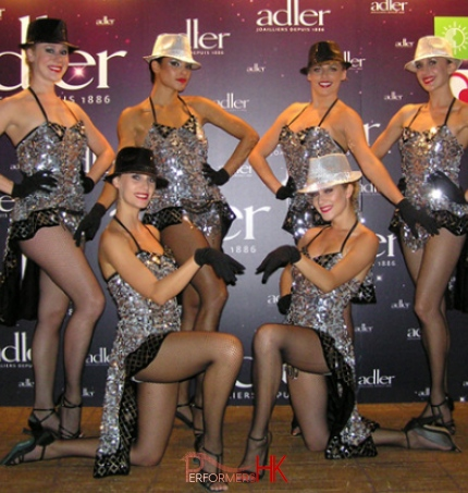 Six Broadway dancers in HK posing in front of the event backdrop with the sliver costume