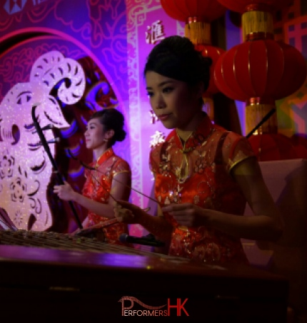 Two Chinese music musician playing Erhu and Yangqin at a Hong Kong Bank annual dinner