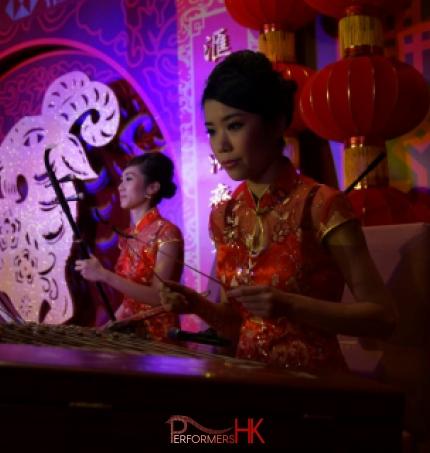 Two Chinese music musician playing Erhu and Yangqin at a Hong Kong Bank annual dinner