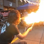 Ling Breathing fire at a street show.