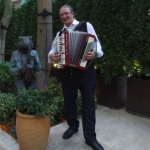 Accordion player at Lee Tung Avenue opening event.