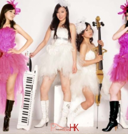 Four electric instrument player in Hong Kong wearing pink and white, taking picture before the corporate event