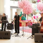 3 musicians playing in mall in HK. Sax, double bass, Keyboard trio