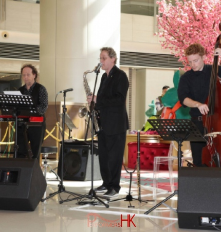 3 live band performers in Hong Kong performing at a corporate event