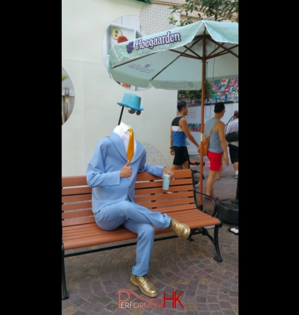 Hong Kong living statue performer in headless man costume at Lee Tung Avenue.