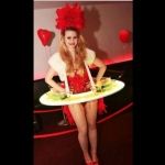 Model wearing LED human canape table costume with red corset