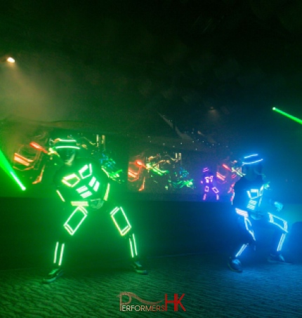 Dancers in multi colored LED costumes
