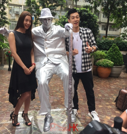 silver levitating man with Parco, HK local celebrity
