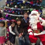 Family with Santa at Xmas time