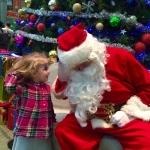 Whispering Christmas wish list to Santa