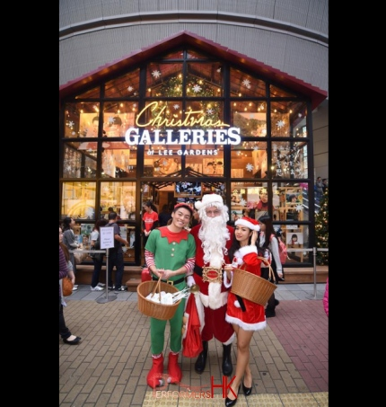 Santa performer with assistants