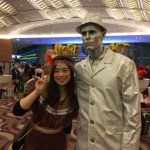 silver man with an attendee at an event