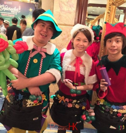 Elf , Santas Helper and another elf performing in shop in Hong Kong