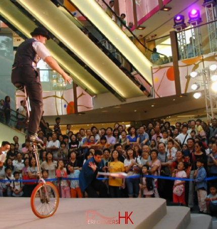 Performing riding a giraffe unicycle for a shopping centre show in SOGO hong kong