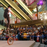 Andy performing for SOGO on his giant unicycle.