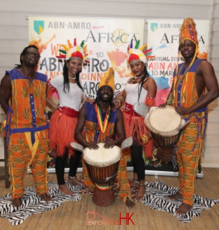 Dancers with drummers at event