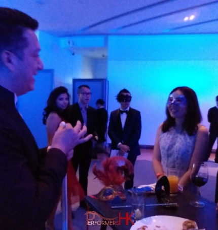 Magician at event with audience members in awe, hong kong sky 100 performance