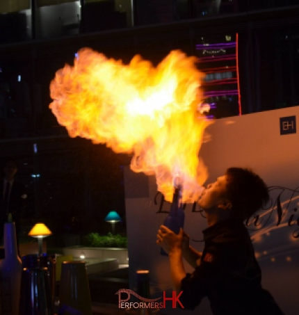 bartender blowing fire at a corporate event mixing cocktails