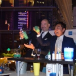 Guests enjoying some interaction with flair bartender