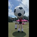 Giant footballs stilts walker at Liverpool sports day Hong Kong