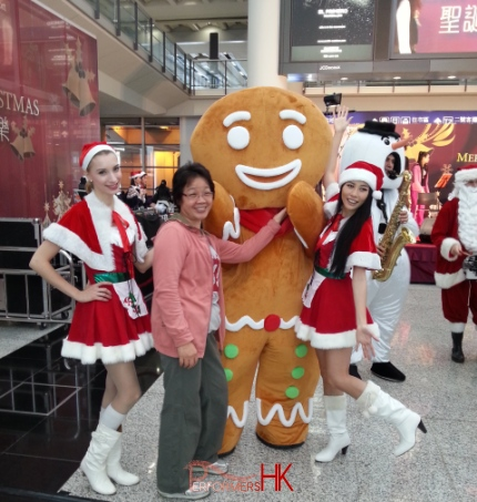 2 models standing with gingerbread man in Hong Kong