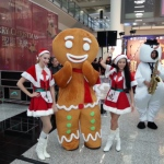 Gingerbread and snowman playing at event in Hong Kong