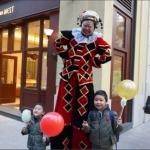 Red and black stilt costume at Lee Tung Avenue wan chai Hong kong