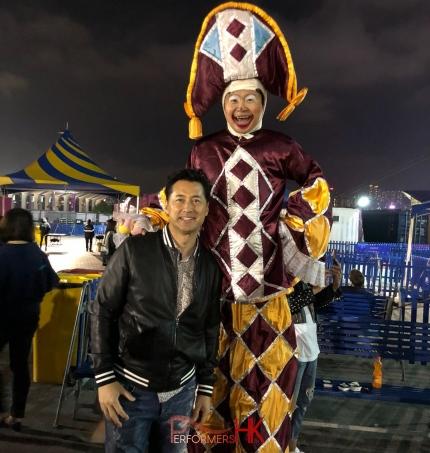 stilt performer with local hong kong celebrity michael wong