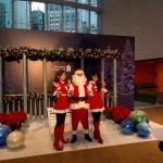 Santa Wayne with 2 Santa girls photo taking with guests