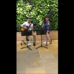 Singer and guitarist performing at Pacific place in Hong kong, casual summer vibe