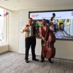 Musicians for an event with french theme playing double bass and accordion