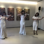 Led violin performance in white dress