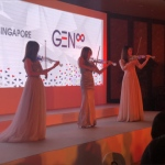 Stage performance with LED violinist trio