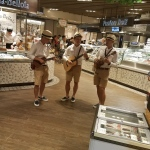Ukulele trio performing at IFC supermarket