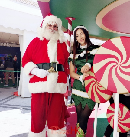 a santa in hong kong, doing an event with elf girl kimmy