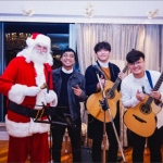 santa martin at a private event with a band in sha tin hk