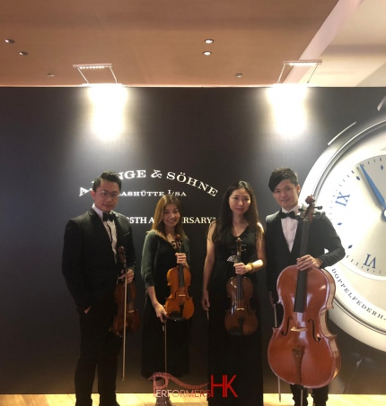 String players at watch maker event