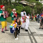 snowman costume character with kids at event