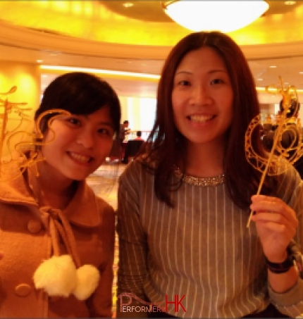 2 female event goer at hotel in hung hum hong kong for hsbc hk event with Sugar painting (糖画)