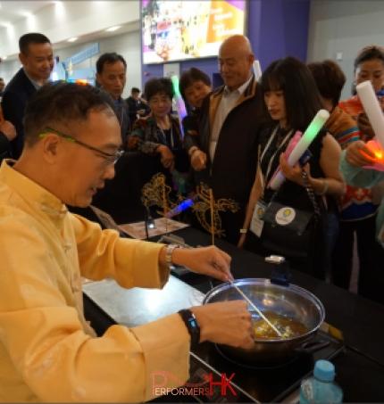 Sugar painting (糖画) sifu at an event at asia world expo hong kong sar