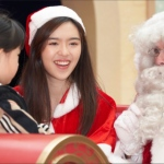 Santa with Santa girl talking to child