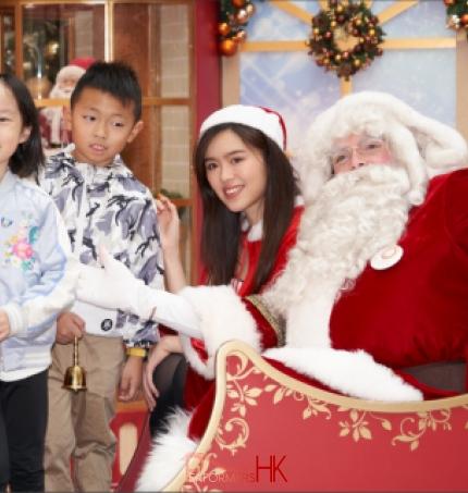 Santa with santa girl and kids